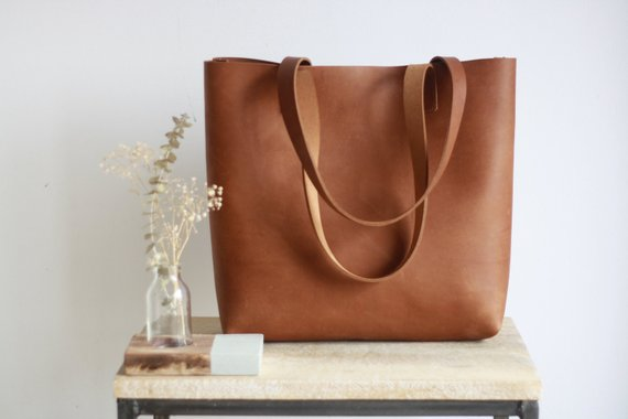 great leather work bag with pockets for your laptop and other gear