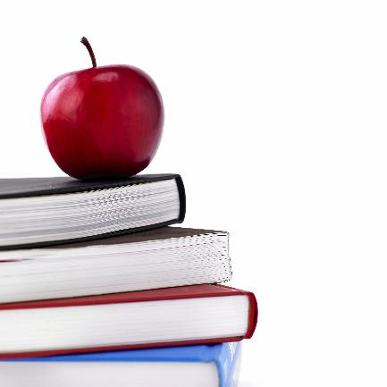 teacher books and an apple