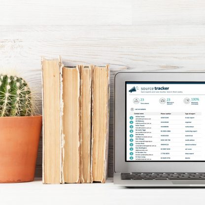 source tracker on laptop screen with books and a cactus